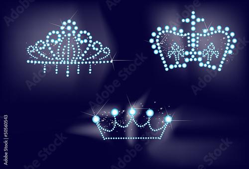three bright crowns on dark background