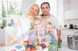 Happy family using futuristic interface to prepare dinner