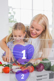 Mother and daughter chopping vegetables with purple holographic