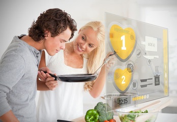 Couple preparing dinner using futuristic interface