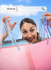 Woman holding up her shopping bags under address bar