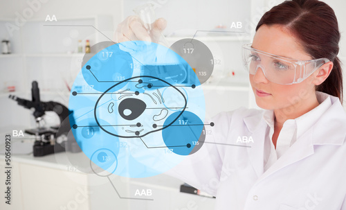 Chemist examining cell interface
