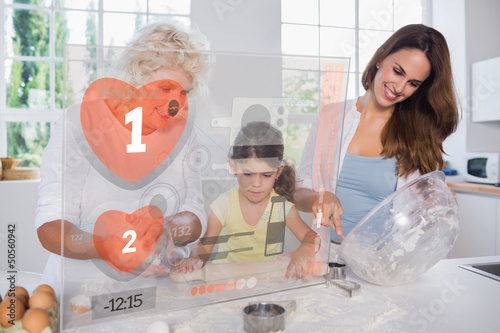 Granny mother and child making cookies with futuristic interface