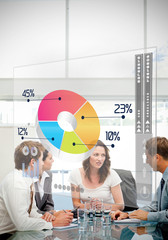 Business workers using colorful pie chart interface