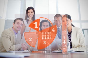 Smiling business workers looking at orange pie chart interface