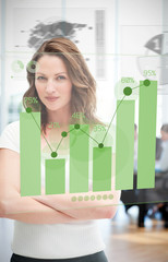 Confident blonde businesswoman using green chart interface
