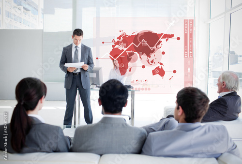 Business people listening and looking at red map diagram interfa