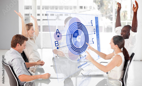 Cheerful business workers using blue diagram interface