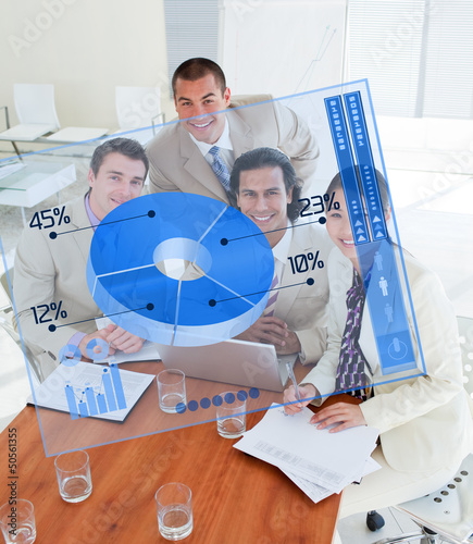 Overview of happy colleagues looking at blue chart interface