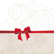 Hintergrund aus Ornamenten und roter Schleife