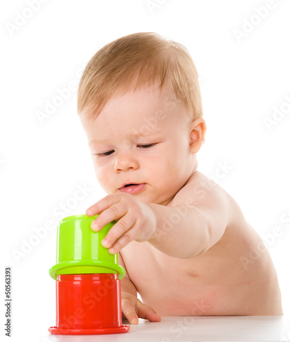 child playing with color pyramid toy. isolated on white
