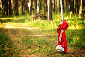 "girl looking up. the fairy tale "" Red Riding Hood"""