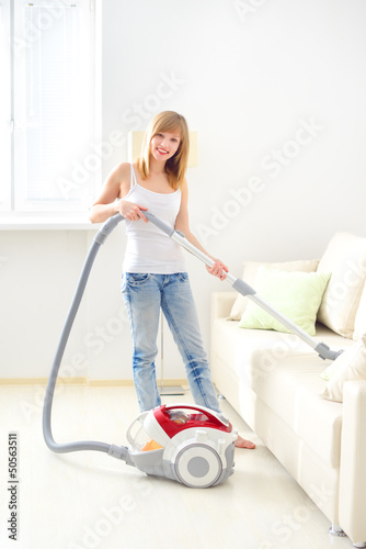 young girl cleaning sofa