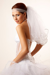 Bride glances over her shoulder