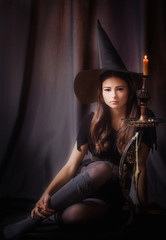 Young beautiful witch