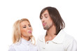 Young couple is showing tongues to each other