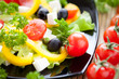 fresh vegetable salad with feta and olives