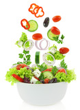 Fototapety Fresh mixed vegetables falling into a bowl of salad
