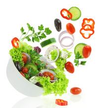 "Постер, картина, фотообои ""Fresh mixed vegetables falling into a bowl of salad"""