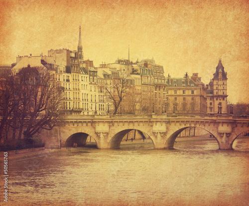 Leinwanddruck Bild Seine.Pont Neuf in central Paris, France. Photo in retro style.