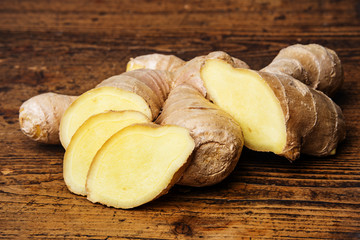 raw ginger on a wooden background