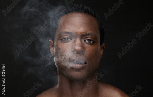 African American Man with Smoke Out of Mouth