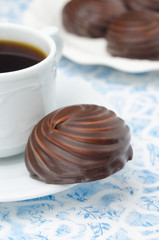 cup of black coffee and marshmallows in chocolate, closeup