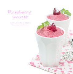 Raspberry mousse with mint and fresh raspberries isolated