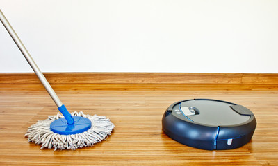 floor cleaning robot and traditional mop in laminate floor