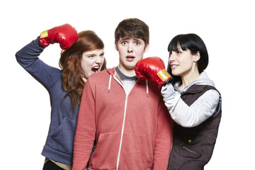Teenage siblings fighting with boxing gloves