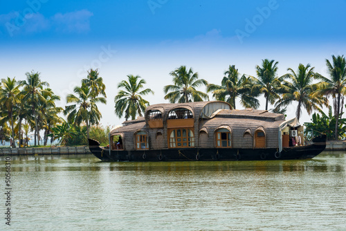 landscape with reflection houseboat in kerala backwaters, India