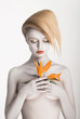 Bodypainting. Enigmatic Woman - Strelitzia flower. Painted Skin