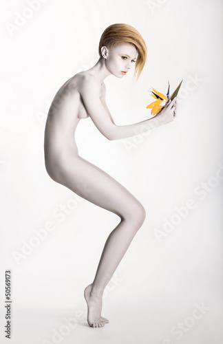 Imaginary. Expressive Woman in Graceful Pose. Statue with Flower