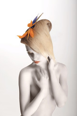 Fairy Tale. Woman with Strelitzia Flower posing. White Makeup