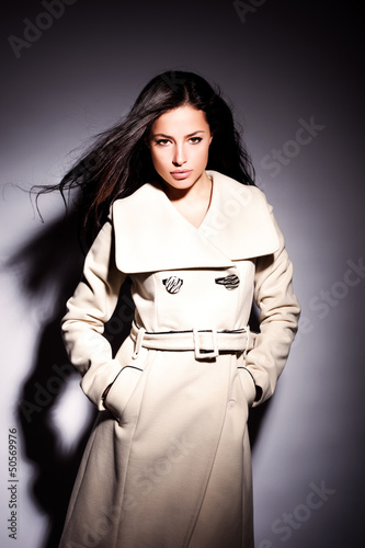 woman in white modern coat