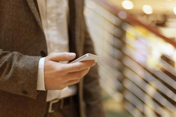Smartphone in hand of businessman