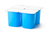 Four plastic containers for dairy products with foil lid