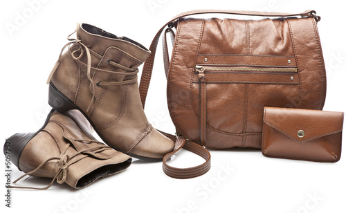 Pair of women shoes and handbag isolated over white