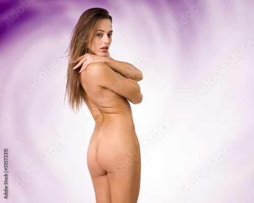 beautiful nude or naked woman with purple background