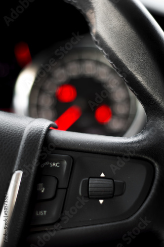 Steering Wheel comands with dashboard as background