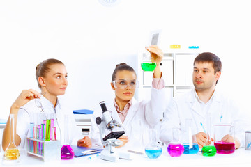 Team of scientists working in laboratory