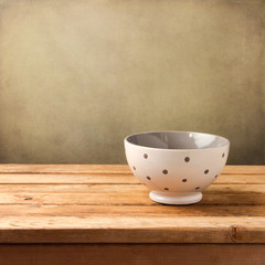 Background with polka dots bowl on wooden vintage table