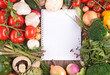 open notebook with assortment of vegetables