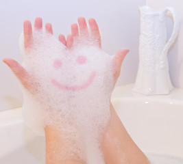 Smile on soap foam on hands