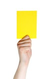 hand holding a yellow card