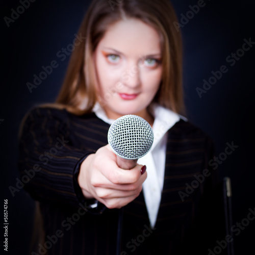 woman with microphone focus on microphone