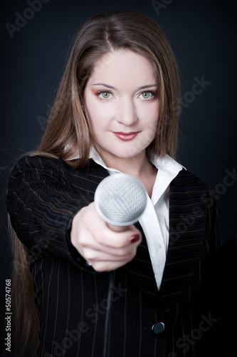 woman with microphone focus on women