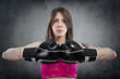 Young beautiful woman with boxing gloves at workout over rusty b