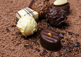 chocolate background with group of  pralines