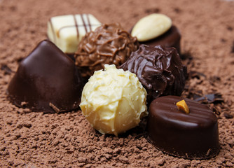 chocolate pralines on chocolate background